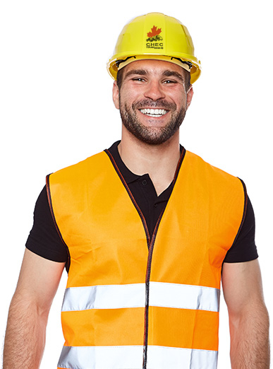 Happy worker wearing a hardhat